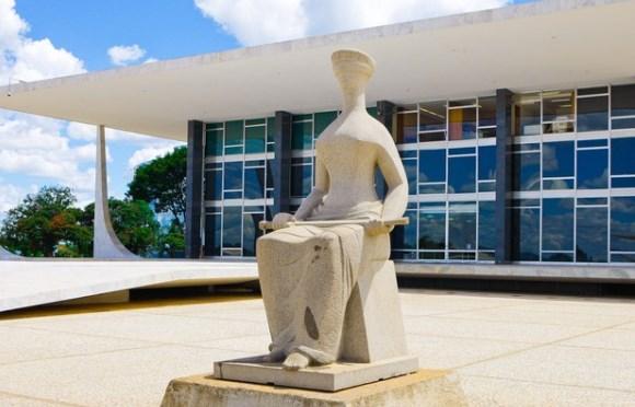 A altura da estátua da Justiça e o orçamento do FGTS